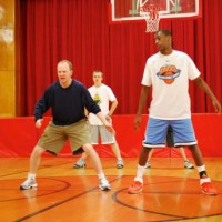 Photo of Coach Lawrence Frank and Hoop Dreamz campers
